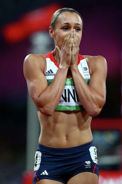 Jessica Ennis of Great Britain celebrates winning gold in the Women's Heptathlon at Olympic Stadium.
