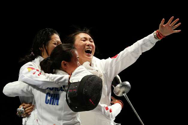 Members of Team China celebrate their 39-25 win over Korea during their Gold Medal Match in the Women's Epee Team Fencing Finals at ExCeL. Photo: Hannah Johnston, Getty Images / 2012 Getty Images