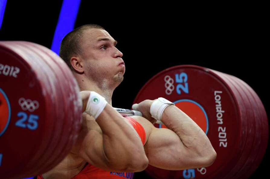 Bronze medallist Anatoli Ciricu of Moldova competes in the Men's 94kg Weightlifting final at ExCeL.