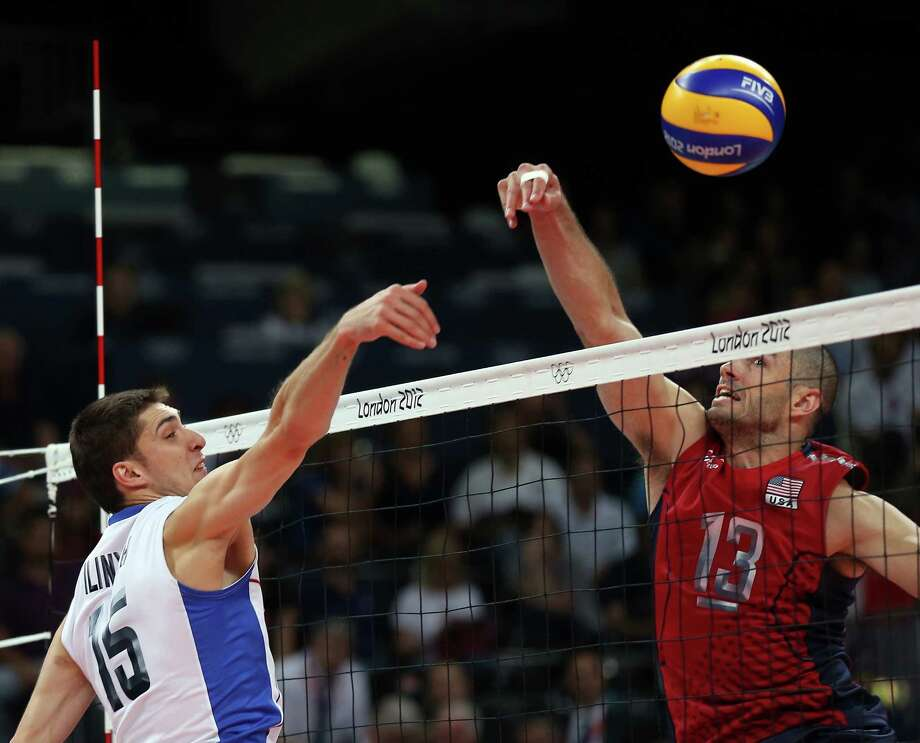 Dmitriy Ilinykh #15 of Russia blocks a shot by Clayton Stanley #13 of the United States during Men's Volleyball at Earls Court. Photo: Elsa, Getty Images / 2012 Getty Images