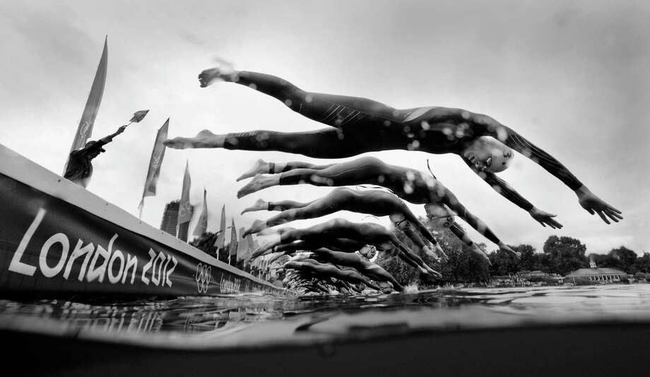 (Image has been converted to black and white.) Athletes begin the swimming leg of the Women's Triathlon at Hyde Park. Photo: Adam Pretty, Getty Images / 2012 Getty Images