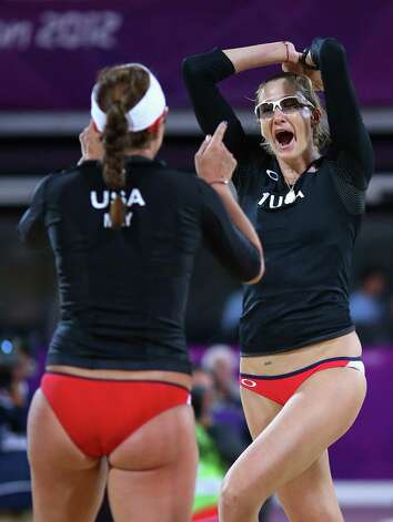 Misty May-Treanor of the United States and Kerri Walsh Jennings of the United States celebrate during the Women's Beach Volleyball Round of 16 match between United States and Netherlands at Horse Guards Parade. Photo: Ryan Pierse, Getty Images / 2012 Getty Images