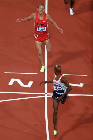 Mohamed Farah of Great Britain looks back  to Galen Rupp of the United States as he crosses the line to win gold in the Men's 10,000m Final at Olympic Stadium. Photo: Ian Walton, Getty Images / 2012 Getty Images