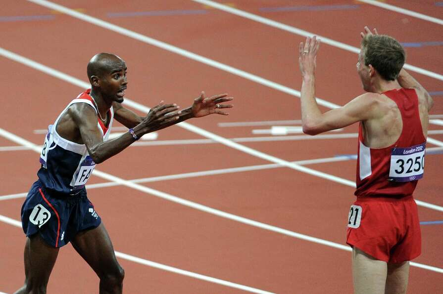 Mohamed Farah of Great Britain celebrates winning the gold medal in Men's 10,000m Final with Galen R