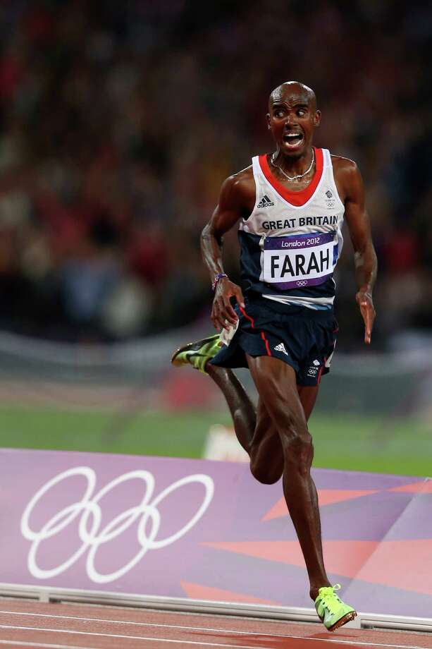 Mohamed Farah of Great Britain crosses the line to win gold in the Men's 10,000m Final at Olympic Stadium. Photo: Quinn Rooney, Getty Images / 2012 Getty Images