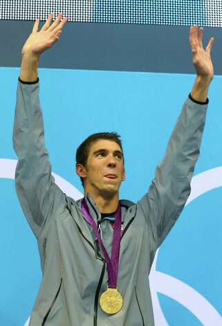 Gold medallist Michael Phelps of the United States celebrates on the podium in the medal ceremony for the Men's 4x100m Meldey Relay Final at the Aquatics Centre. Photo: Al Bello, Getty Images / 2012 Getty Images