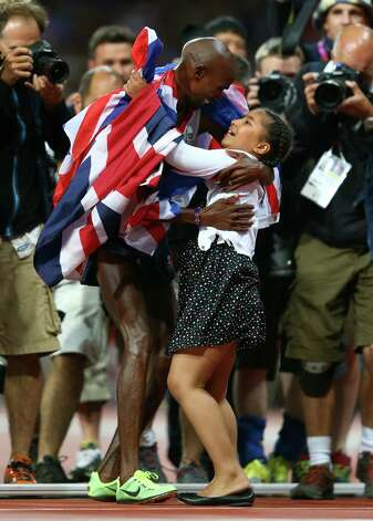 Mohamed Farah of Great Britain celebrates winning gold in Men's 10,000m Final with his daughter Rihanna Farah at Olympic Stadium. Photo: Michael Steele, Getty Images / 2012 Getty Images