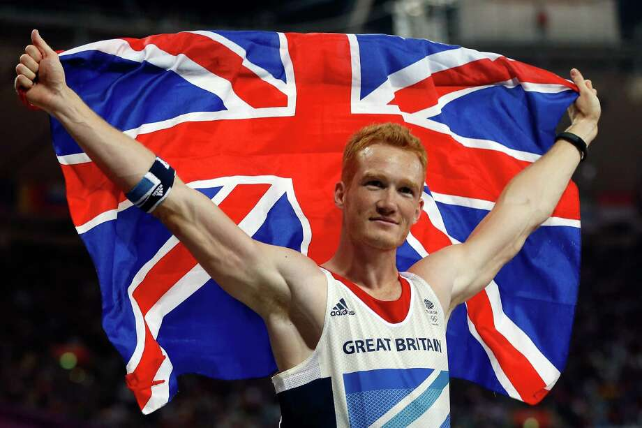 Greg Rutherford of Great Britain celebrates winning gold in the Men's Long Jump Final at Olympic Stadium. Photo: Jamie Squire, Getty Images / 2012 Getty Images