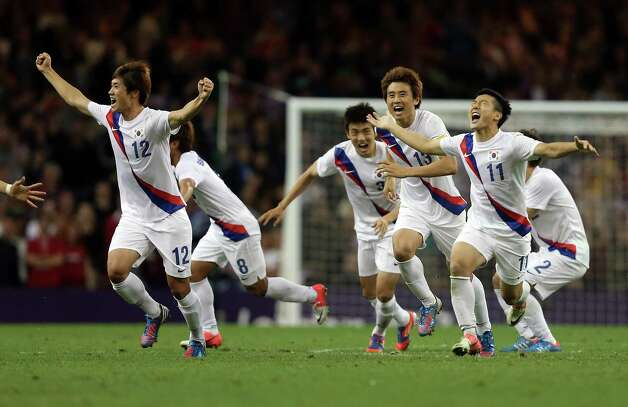 South Korea players celebrate winning the penalty shoot out during the Men's Football Quarter Final match between  Great Britain and South Korea, at Millennium Stadium in Cardiff, Wales. Photo: Julian Finney, Getty Images / 2012 Getty Images