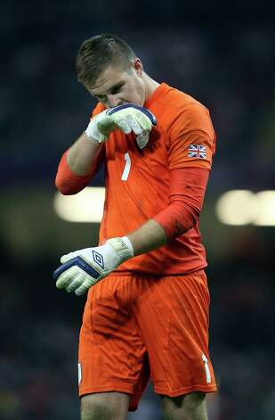Jack Butland of Great Britain looks dejected after their penalty shoot out loss during the Men's Football Quarter Final match between  Great Britain and South Korea, at Millennium Stadium in Cardiff, Wales. Photo: Julian Finney, Getty Images / 2012 Getty Images