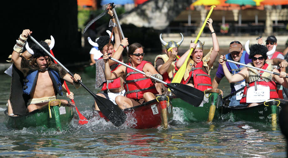 A group of U.S. Army personnel from Fort Sam Houston don Viking costumes as they participate in the 44th annual Ford Canoe Challenge along the River Walk on Saturday, August 4, 2012. About 100 teams that included Boy Scouts and Girls Scouts, corporate and celebrity participants took part in one of the oldest events held on the river. Photo: Kin Man Hui, SAN ANTONIO EXPRESS-NEWS / ©2012 San Antonio Express-News