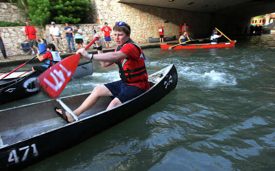 Wesley Cook of Troop 471 shoves off from the starting line at the 44th annual Ford Canoe Challenge along the River Walk on Saturday, August 4, 2012. About 100 teams that included Boy Scouts and Girls Scouts, corporate and celebrity participants took part in one of the oldest events held on the river. Photo: Kin Man Hui, SAN ANTONIO EXPRESS-NEWS / ©2012 San Antonio Express-News