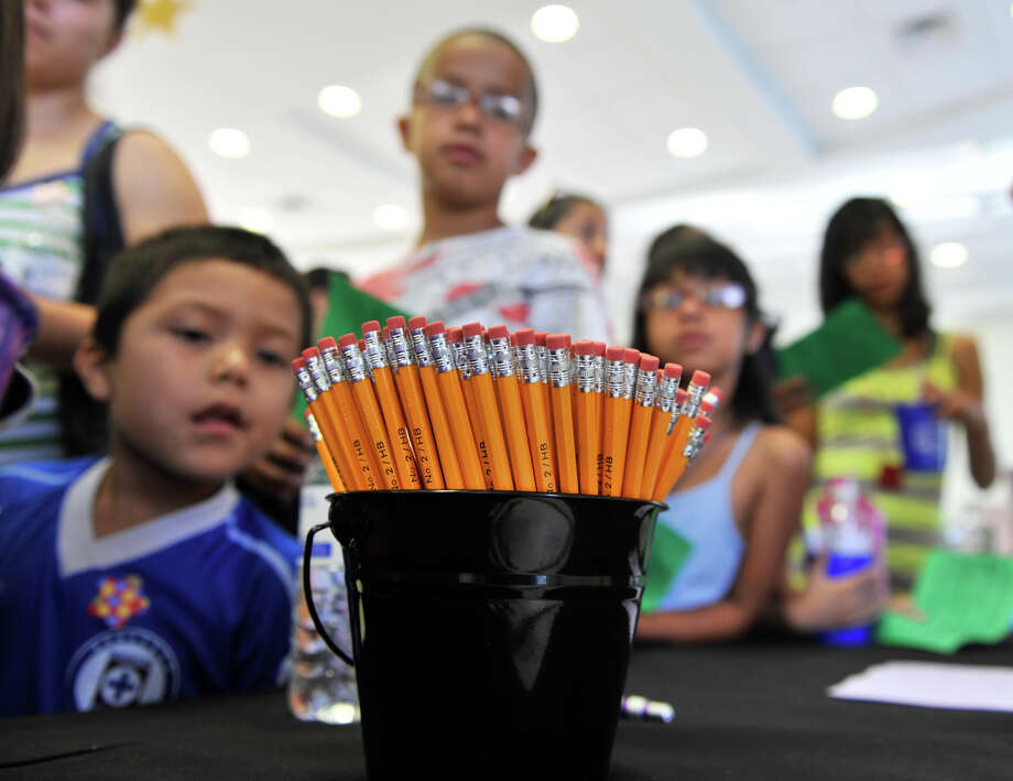 SLUG: Childhood Promise-AssignID 443148-August 4, 2012-San ANtonio, Texas-Pencils await Harlandale School students Saturday morning as supplies were distributed to need students through a project created by former student, Juan Mancha. Photo: Robin Jerstad/For The Express-Ne