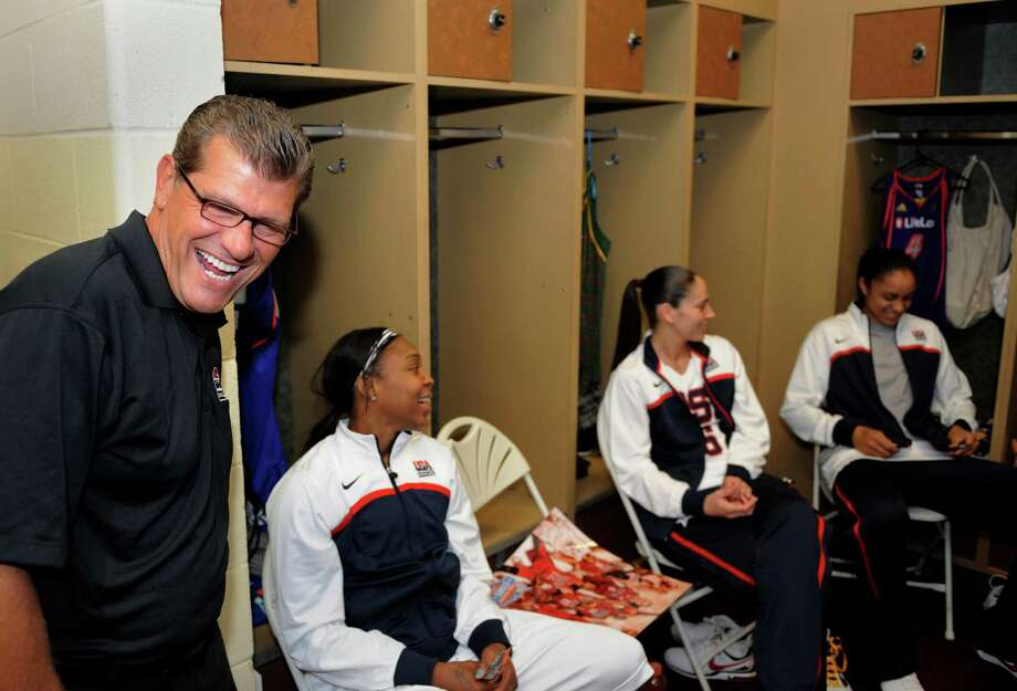 This photo made July 10, 2010, shows Geno Auriemma, head coach of Team USA,  sharing a moment with team members before his teams' basketball game against the WNBA All-stars in Uncasville, Conn.. Players from left to right are Cappie Pondexter, Sue Bird and  Candice Dupree. (AP Photo/Fred Beckham) Photo: Fred Beckham, ST / FR153656 AP