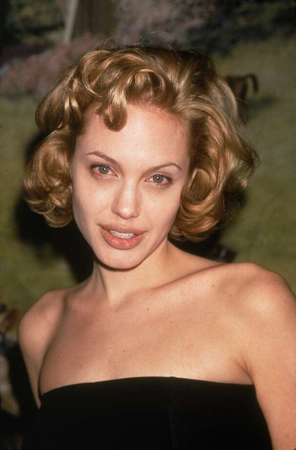 Before Angelina Jolie dominated the actress A-list, she didn't always exude Hollywood glamour. Here's Jolie's awkward, blond, blue-contacts phase of 1998.  (Getty Images)