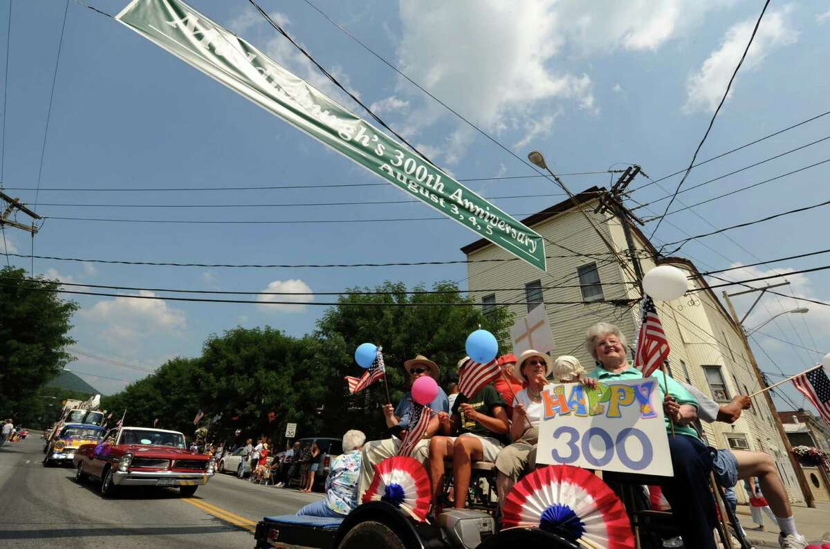 The Middleburgh Golden Agers ride on a float during the Middleburgh 300th anniversary parade on Main Street in Middleburgh NY Saturday Aug. 4, 2012. (Michael P. Farrell/Times Union)