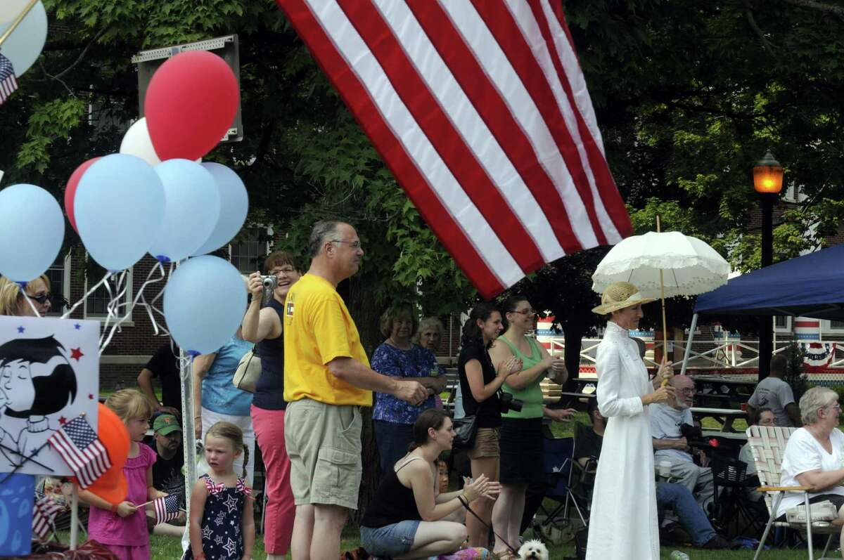 People line MainStreet to watch the Middleburgh 300th anniversary parade in Middleburgh NY Saturday Aug. 4, 2012. (Michael P. Farrell/Times Union)