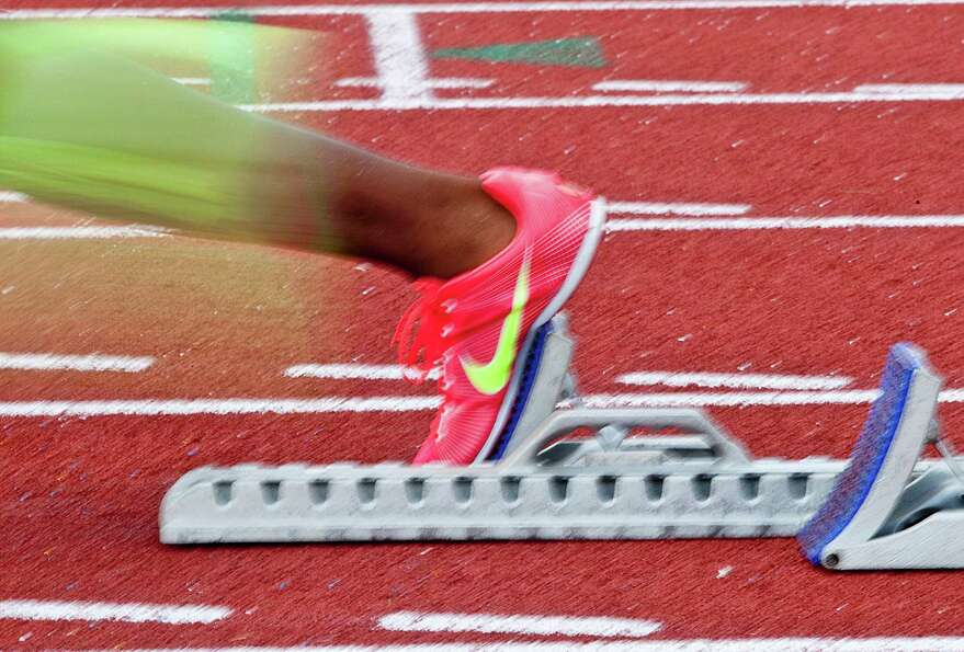 A runners foot leaves the starting block at the Jr. Olympics.