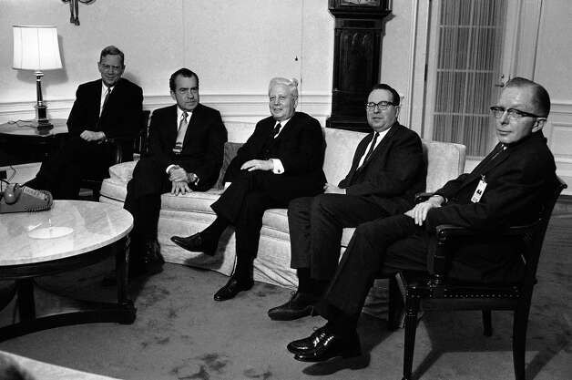 "FILE - In this Jan. 23, 1969 file photo, President Richard Nixon, second from left, poses at the White House in Washington, with four government officials he named as his economic ""Quadriad."" From left are: Chairman William M. Chesney Martin Jr., of the Federal Reserve Board; Nixon; Secretary of the Treasury David M. Kennedy; Budget Director Robert Mayor and Chairman Paul McCracken of the Council of Economic Advisers. McCracken, right, a former economic adviser to several U.S. presidents, has died at age 96. Retired University of Michigan business professor and longtime friend Herbert Hildebrandt says he was told Friday, Aug. 3, 2012, of McCracken's death by Linda Langer, one of McCracken's daughters. (AP Photo/ Harvey Georges, File) Photo: Harvey Georges"