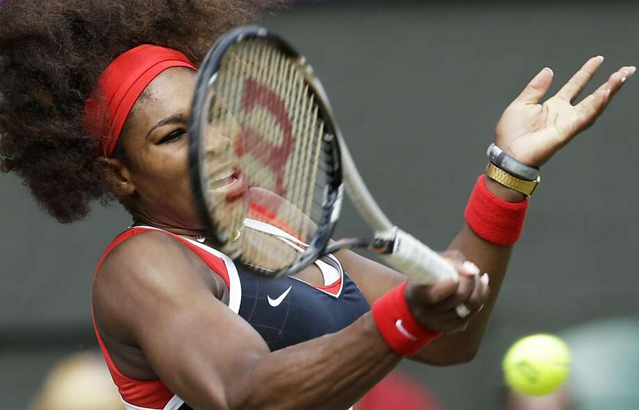 Serena Williams dominated with her serve and repeatedly blasted winners from the baseline to become the second woman to win the Golden Slam. Steffi Graf was the first. Photo: Victor R. Caivano, Associated Press