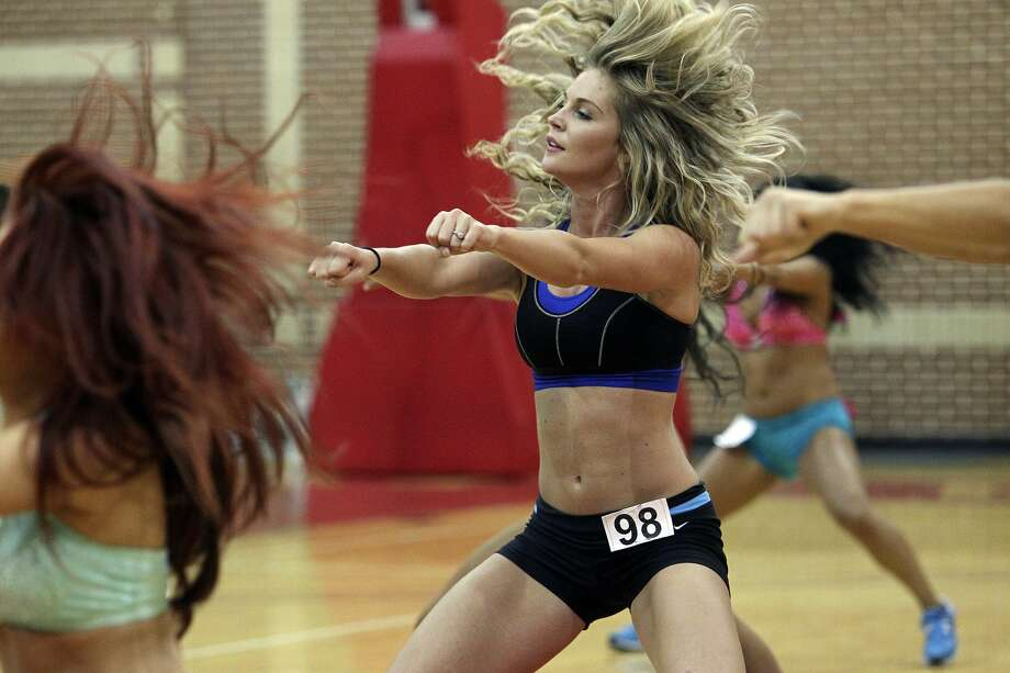 Lossie Parker dances as hopefuls tryout for the Silver Dancers squad at the University of the Incarnate Word Convocation Center on August 4, 2012.  (Tom Reel / San Antonio Express-News)