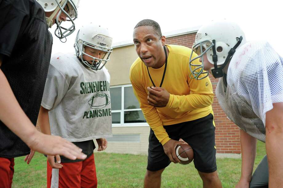 Comanche assistant coach Derek Brown, center, holds a huddle with offensive players during Shenendehowa Junior Plainsmen Football practice on Wednesday, Aug. 1, 2012, at Shenendehowa High in Clifton Park, N.Y. (Cindy Schultz / Times Union) Photo: Cindy Schultz / 00018660A