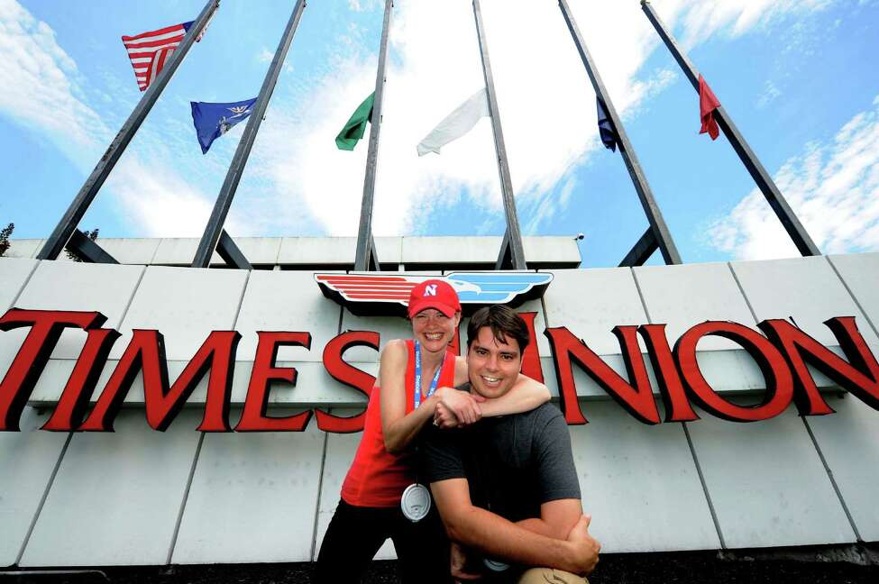 Jenn Gish, left, and Pete Iorizzo had a competition to see who can do the most Olympic events in the Capital Region in a four-hour span Friday Aug. 3, 2012. (Michael P. Farrell/Times Union)