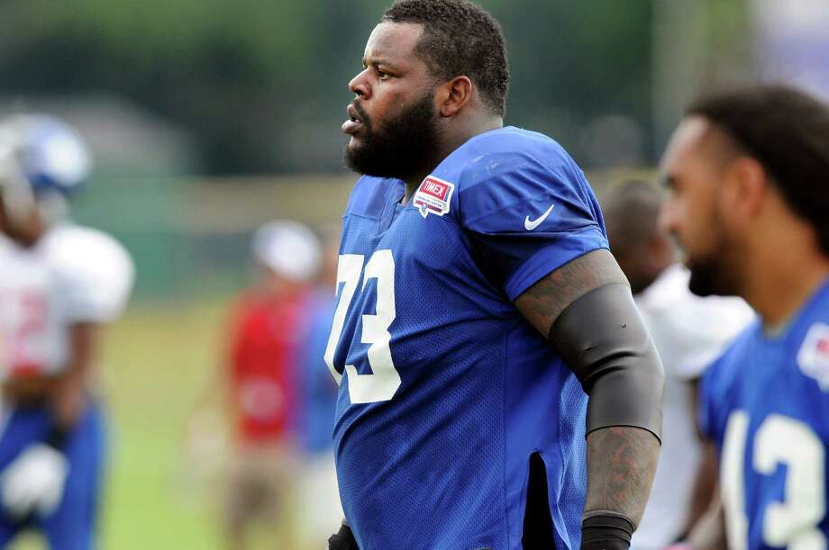 New York Giant Shaun Rogers (73) practices during Giants Camp on Saturday, Aug. 4, 2012, at UAlbany in Albany, N.Y. (Cindy Schultz / Times Union) Photo: Cindy Schultz / 00018641A