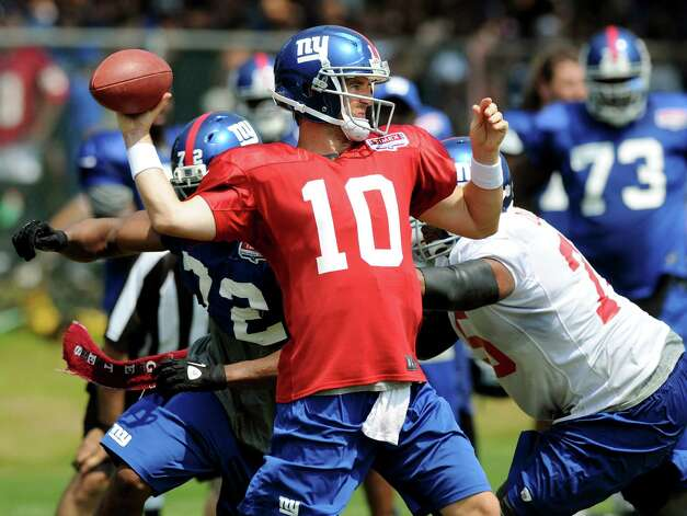 New York Giants quarterback Eli Manning (10) throws a pass during Giants Camp on Saturday, Aug. 4, 2012, at UAlbany in Albany, N.Y. (Cindy Schultz / Times Union) Photo: Cindy Schultz / 00018641A