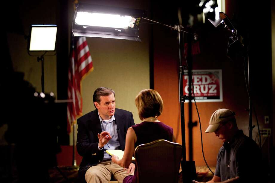 Ted Cruz, the GOP nominee for U.S. Senate, gives a television interview after the tea party wave helped him defeat Lt. Gov. David Dewhurst in last week's runoff. Photo: Brett Coomer / © 2012 Houston Chronicle
