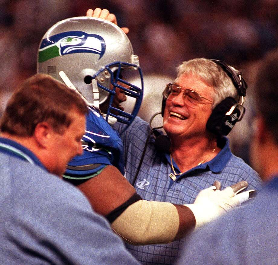 Seahawks head coach Dennis Erickson congratulates Cortez Kennedy on his first NFL touchdown, a 39-yard run in the fourth quarter, as Kennedy returns to the bench for some oxygen. Photo: MIKE URBAN