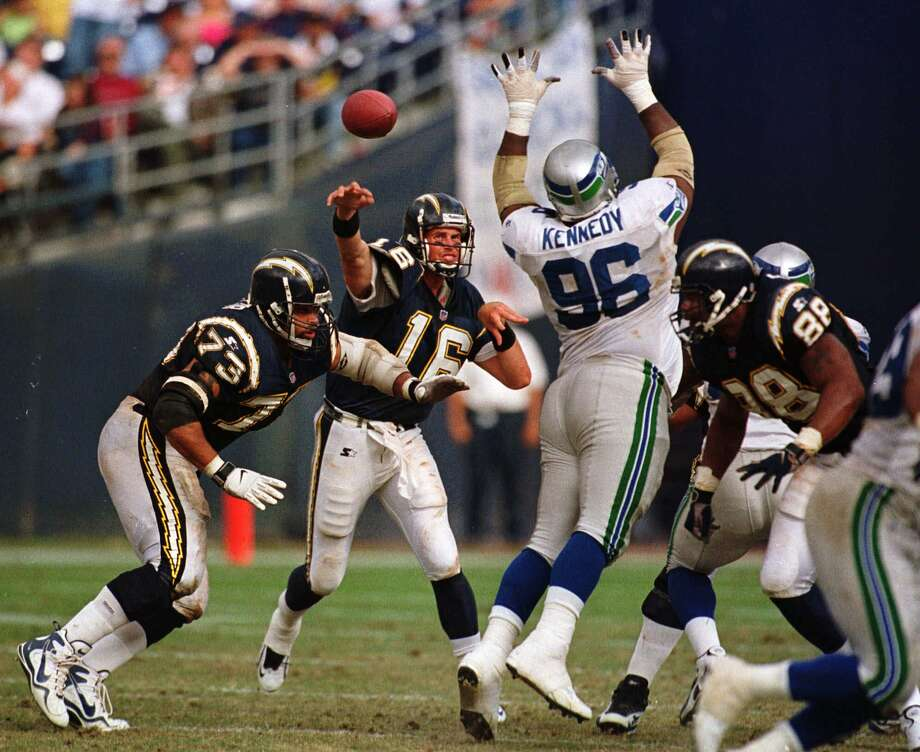 Cortez Kennedy (96) gets his hands up to knock down a pass by San Diego Chargers quarterback Ryan Leaf (16) during the Seahawks' 27-20 victory, Oct. 25, 1998, in San Diego. The Seahawks knocked down five passes in the game. Photo: LENNY IGNELZI, Associated Press / AP