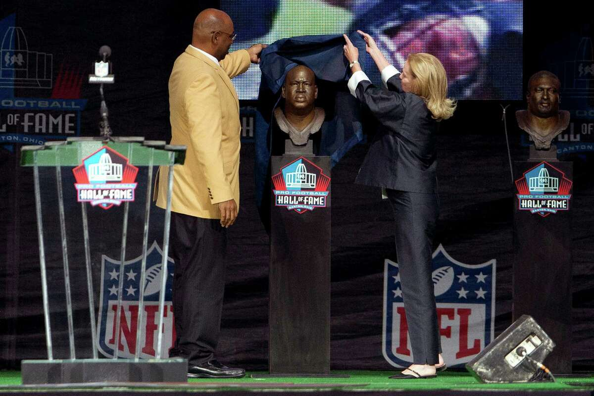 Former Seattle Seahawks defensive tackle Cortez Kennedy (left), presented by Dixie Fraley Keller, the widow of his longtime agent and friend Robert Fraley, during the Class of 2012 Pro Football Hall of Fame Enshrinement Ceremony at Fawcett Stadium in Canton, Ohio on Aug. 4, 2012.