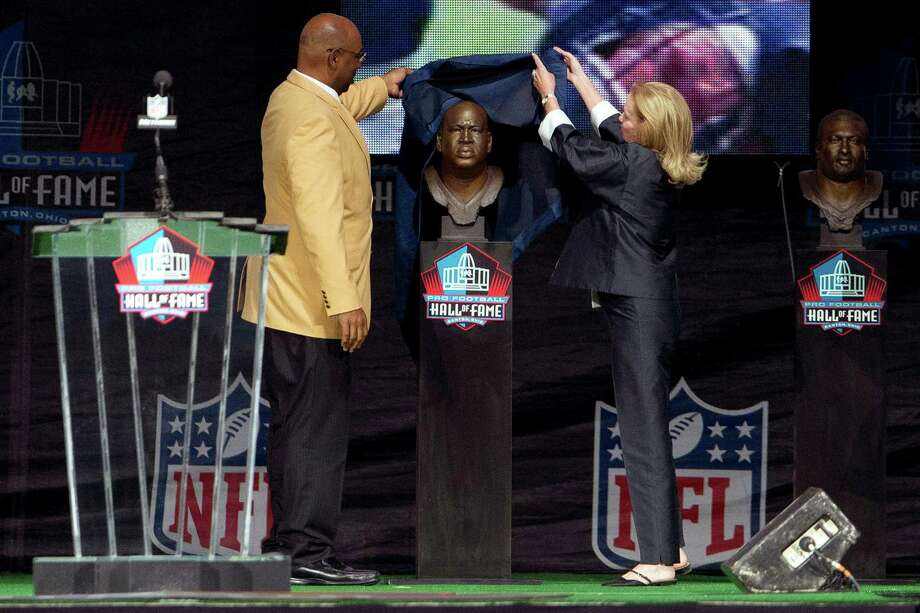 Former Seattle Seahawks defensive tackle Cortez Kennedy (left), presented by Dixie Fraley Keller, the widow of his longtime agent and friend Robert Fraley, during the Class of 2012 Pro Football Hall of Fame Enshrinement Ceremony at Fawcett Stadium in Canton, Ohio on Aug. 4, 2012. Photo: Jason Miller, Getty Images / 2011 Getty Images