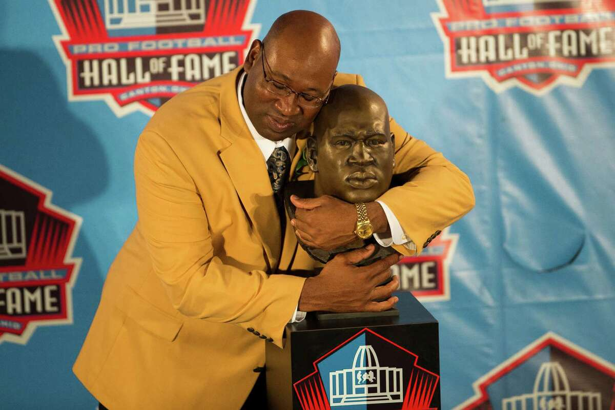 Former Seahawks defensive tackle Cortez Kennedy with his bust during the Class of 2012 Pro Football Hall of Fame Enshrinement Ceremony.