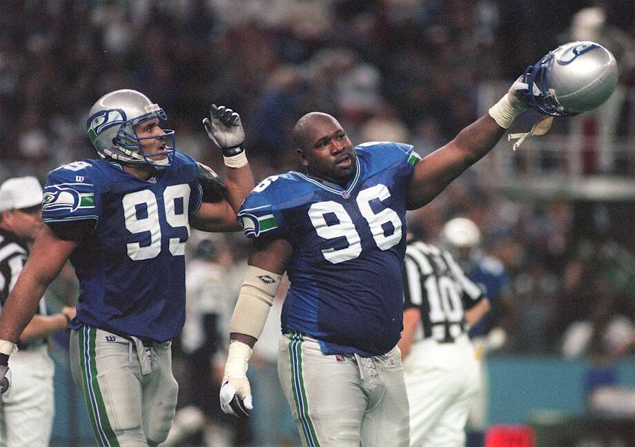 Michael McCrary (99) and Cortez Kennedy (96) celebrate as they leave field after stopping the San Diego Chargers in 1996. Photo: GRANT M. HALLER