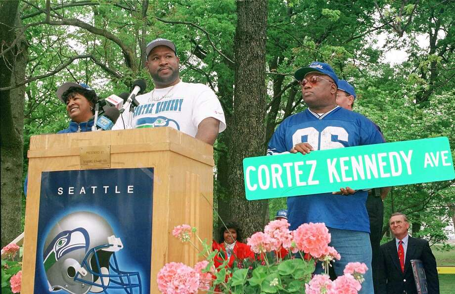 "Seahawks defensive tackle Cortez Kennedy, center, speaks during a ceremony to rename part of Arkansas Highway 61 ""Cortez Kennedy Avenue"" on April 18, 1998, in Wilson, Ark. Cortez is flanked by his mother Ruby Harris, left, and Joe Harris,right. Photo: DAVID STOUT, ASSOCIATED PRESS  / THE JONESBORO SUN"