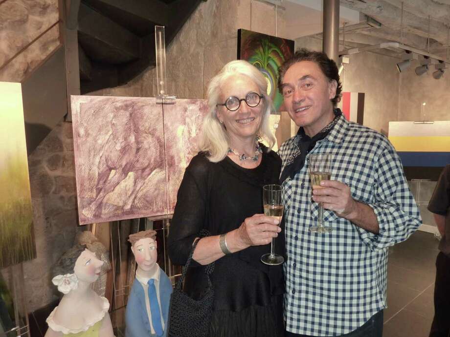 Greenwich artist Marian ìBingíí Bingham and Washington, D.C., art dealer Victor Gaetan at a Paris art opening Thursday, Aug. 2, 2012, celebrating the return of her paintings that were confiscated eight months ago along with artworks of four other artists on the border of Serbia and Romania by Serbian customs officials. Photo: Contributed Photo