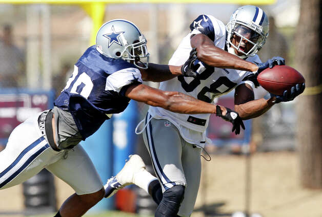 Dallas Cowboys cornerback Brandon Carr (left) defends wide receiver Dez Bryant as he catches a pass during 2012 training camp held Saturday Aug 4, 2012 in Oxnard, CA. Photo: Edward A. Ornelas, Express-News / © 2012 San Antonio Express-News