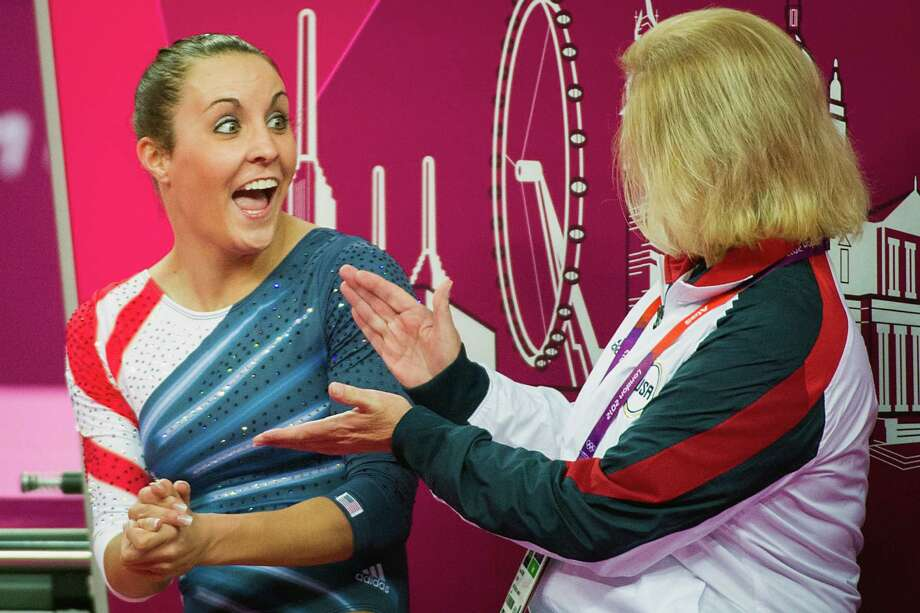 Savannah Vinsant reacts with her coach Tara Guidry after hearing her score qualified her for the finals in women's trampoline at the 2012 London Olympics on Saturday, Aug. 4, 2012. Vinsant, from Newton, Texas, finished in sixth place after becoming the first U.S. trampolinist to qualify to the finals at a Olympic Games. Photo: Smiley N. Pool, Houston Chronicle / © 2012  Houston Chronicle