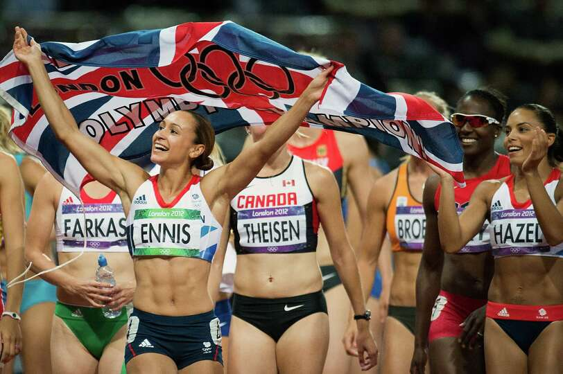 Jessica Ennis of Great Britain celebrates after winning the gold medal the women's heptathlon at the