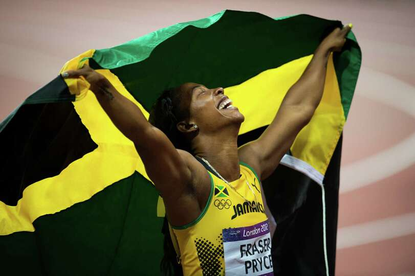 Shelly-Ann Fraser-Pryce of Jamaica celebrates after winning the women's 100-meter final at the 2012