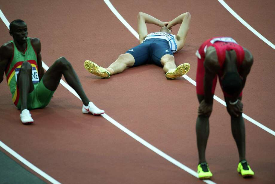 Kerron Clement of the USA, right, Britain's David Greene,center, and Mamadou Kasse Hanne of Senegal react after competing in a men's 400-meter hurdles semifinal at the 2012 London Olympics on Saturday, Aug. 4, 2012. Photo: Smiley N. Pool, Houston Chronicle / © 2012  Houston Chronicle