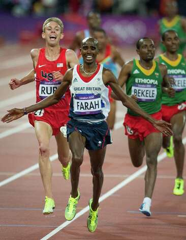 Mo Farah of Great Britain crosses the finish line ahead of Galen Rupp of the USA to win the men's 10,000-meter final at the 2012 London Olympics on Saturday, Aug. 4, 2012. Rupp took silver in the event for just the third USA medal in the 10,000-meters, the last coming in 1964. Rupp and Farah are training partners in Oregon. Photo: Smiley N. Pool, Houston Chronicle / © 2012  Houston Chronicle