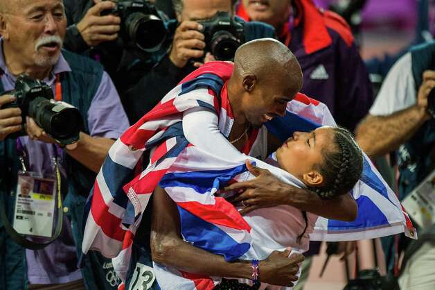 Mo Farah of Great Britain hugs his daughter Rihanna after winning the men's 10,000-meter final at the 2012 London Olympics on Saturday, Aug. 4, 2012. Photo: Smiley N. Pool, Houston Chronicle / © 2012  Houston Chronicle