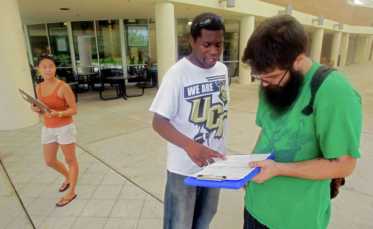 Young voters register fellow students at the University of Central Florida in Orlando, Fla.