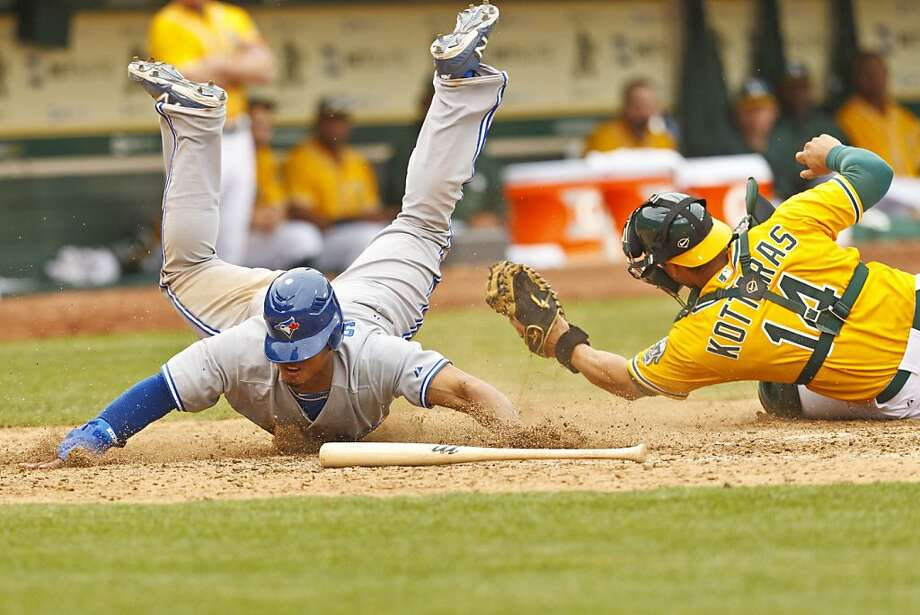 George Kottaras tags out Moises Sierra to end the 11th inning, but the damage had already been done. Photo: Jason O. Watson, Getty Images