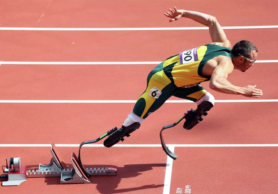 Oscar Pistorius of South Africa became the first double-amputee runner to compete in the Olympics. His historic 400-meter race drew heat from some who question whether his prosthetic legs gave him an advantage. Photo: Paul Gilham / 2012 Getty Images