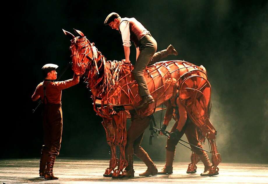 "Andrew Veenstra as the principal character Albert mounts his puppet horse  Joey for the first time in ""War Horse"" now playing at the Curran Theatre in San Francisco Thursday August 2, 2012. Photo: Lance Iversen, The Chronicle"