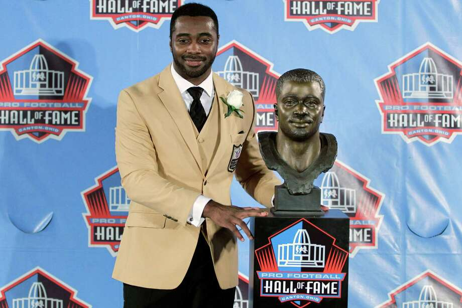 Curtis Martin poses with a bust of himself during an induction ceremony at the Pro Football Hall of Fame, Saturday, Aug. 4, 2012, in Canton, Ohio. (AP Photo/Gene J. Puskar) Photo: Gene J. Puskar / AP